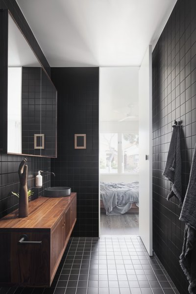 A look inside the black ensuite bathroom on the ground floor.