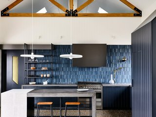 Fitted out in custom concrete bench tops are Voodoo by Colour Concrete Systems and custom shelving, the luxury kitchen was built with integrated appliances for a streamlined appearance.