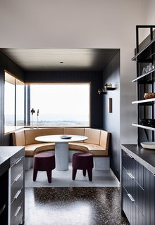 Inspired by intimate dinners with friends in Japan, the curved dining nook mimics the Japanese 'chabudai' tables that seat people close together.