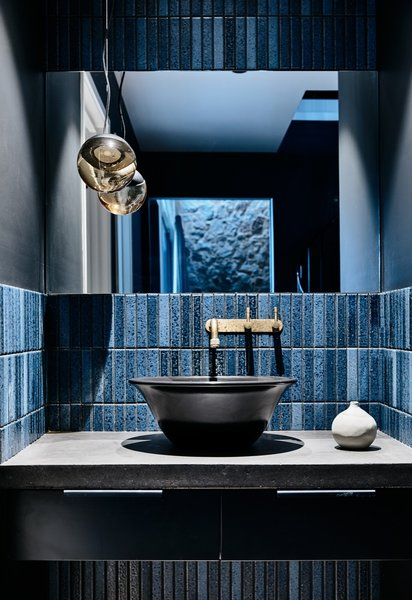 """""""The wash nook in the hallway references the Japanese bathing tradition of having a bath and shower separate to the washbasin and toilet,"""" explain the designers. The separation of spaces is also crucial in this home, which has three bedrooms."""