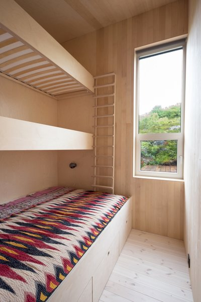 In one of the bedrooms, custom bunk beds sleep three.