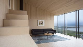 The project celebrates local Norwegian craft and materials. The living room holds an Outline sofa by Norwegian designers Anderssen & Voll for Muuto.