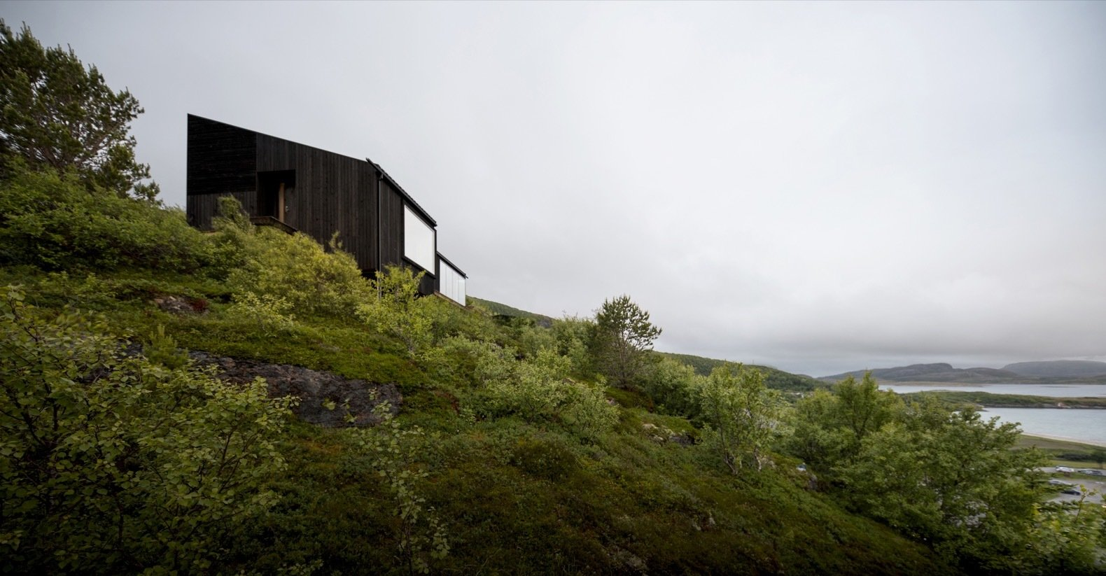Photo 6 Of 19 In A Matte Black Cabin Steps Down The Steep Slopes