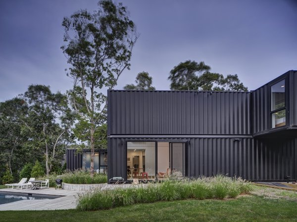 The architects applied BM marine-grade paint to the containers' corrugated metal walls. The home is deliberately compact to match the scale of the neighborhood homes