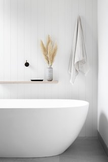A Kado Lussi freestanding bathtub anchors the shared bathroom.