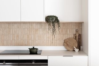 """The terra-cotta backsplash in the kitchen is probably most people's favorite feature. It was such a simple way to tie all the colors together in the house,"" adds Rebecca."