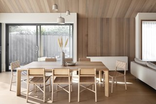 The Leÿer-designed Victoria ash dining table is paired with leather-and-timber GlobeWest dining chairs. Potter Halo pendant lights from Anchor Ceramics hang from the ceiling.