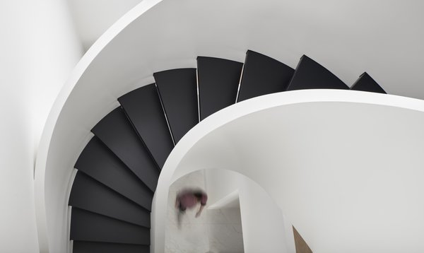 The central staircase connects all three floors of the 7,000-square-foot Toronto townhouse.