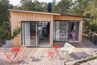 """The deck and living room host spaces for daytime activities,"" says Berensson. ""After crossing the bridge, you can enjoy the sunset over the Stockholm Archipelago from on top of the sauna house."""