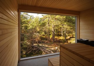 Untreated fir lines the interior of the sauna, which faces a stunning view of the island landscape.