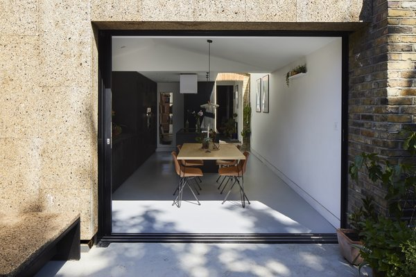 """""""The sliding doors add to the ground-floor layout, especially in the summer where you can open up the whole space into the garden and the studio. It works so well, and makes us want to stay in London for most of the summer months."""""""