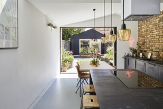 To create a strong connection between the home and the spacious rear garden, the couple emphasized spaces at the rear of the home and added full-height sliding pocket doors for unobstructed views of the garden.