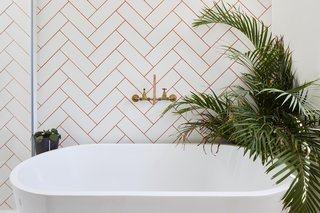 The freestanding bathtub is from Soak.com.