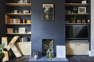 The living room features Conran paint in Highland Rainy Slate. The dyed concrete fireplace hearth was poured in situ.
