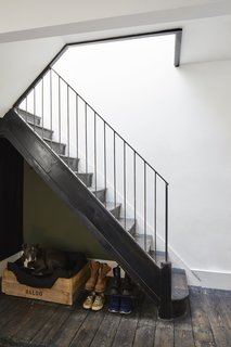The stairs were stripped back to just the steps and upgraded with a new steel handrail and spindles. The treads were finished with OSMO ebony oil.