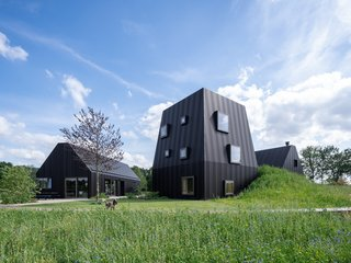 Referencing the farmhouse typology ties the building into its agricultural setting, while helping the project's various functions—a residence, cooking studio, and guest suite—read as a unified whole across 7,352 square feet.