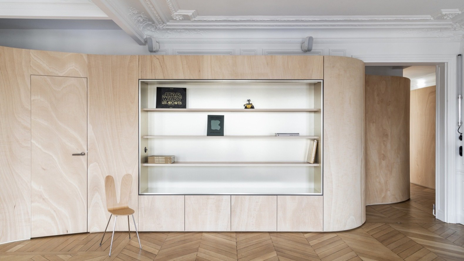 A Giant Ribbon of Wood Wraps This Mind-Bending Parisian Apartment