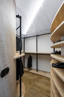 """A peek inside the master suite dressing room. As with all the bathrooms, the dressing room is topped with a new ceiling made from alveolar polycarbonate. """"It imparts a fun twist and provides some natural light to all the areas behind the wooden walls, except for the bedrooms,"""" adds Toledano."""
