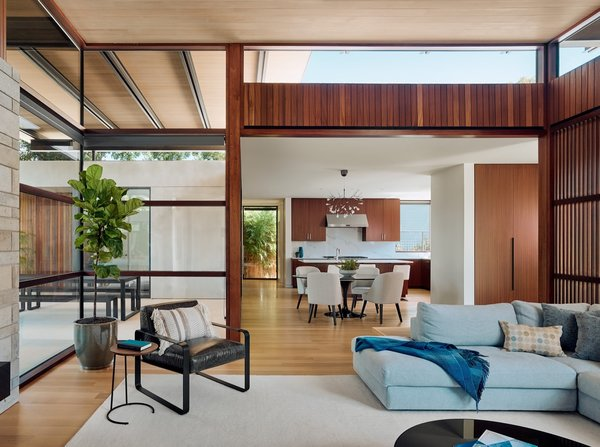The homeowners took advantage of virtual reality technology for selecting and placing their furniture, including the pictured Reid section from DWR and Black Marble Saarinen dining table with Cora custom side chairs from Room and Board.