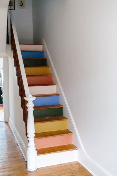 """We had the brainy idea to combine all of the crazy colors throughout the house into a color palette going during the stairs,"" says Claudia. ""So now, when you walk into the house, you are hit with a beautiful presentation on the staircase of all the colors you are going to see throughout the house."""
