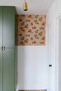 """Note the scrap of 19th-century wallpaper in the kitchen. """"We managed to save it, and I just adore the charm and color it brings,"""" says Claudia. """"I am thrilled to the bone when I am able to tell a small piece of the story of the original homeowner's style."""""""