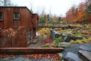 Located two hours north of Boston, the Rocky Brook weeHouse is carved out of the grade of a steep creekside lot.