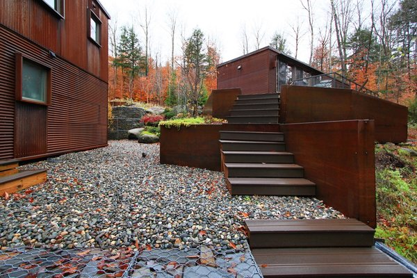 Gabions and loose stone create walkable pervious surfaces.