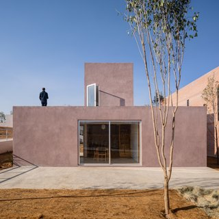 """The top of the home can be used as an elevated terrace. """"The roof references the vernacular of rural houses, as does the traditional rainwater drainage system,"""" say the architects."""