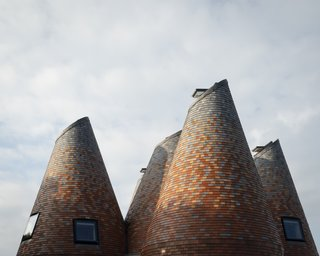 Bumper Oast's frame was built with thick timber modules topped with prefabricated cones craned into position.