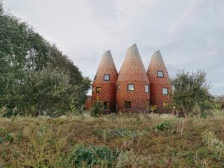 Five Tile-Clad Towers Forge a Fantastical Home Inspired by Hop Kilns