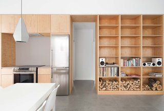 All of the integrated storage units and cabinetry are made of affordable maple veneer panels.