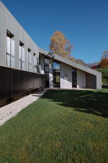"""The north and south facades are set back in relation to the wood paneling so that they are perceived as framing."""