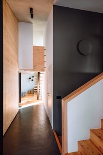 Dark gray accents provide contrast to the predominate use of larch and pine inside the home.