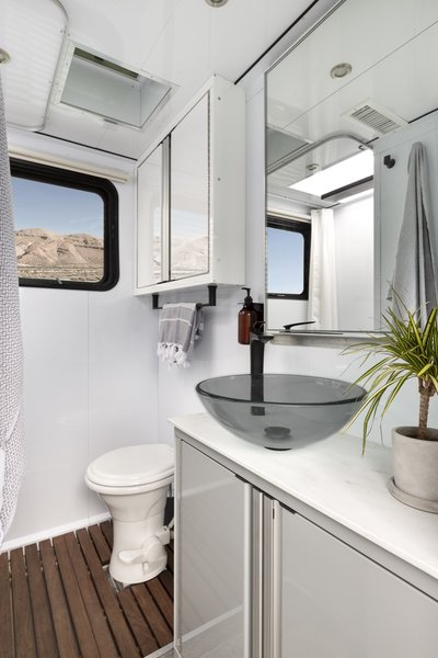 The standard Living Vehicle models come with an all-porcelain, foot-flush toilet. Customers can also upgrade to an electric toilet with a bidet or a composting toilet.