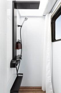 """The spa-style bathroom includes a 32"""" x 36"""" wet-dry shower with a rainfall shower head and a skylight above."""