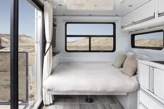 The dining/living area transforms into a queen-sized bed. A Euro Loft option increases sleeping capacity to six with a hidden full-size bunk that lowers from the ceiling.