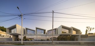 """All components were prefabricated in a factory and quickly assembled on-site. The system """"performs at once as structure, insulation, and cladding elements,"""" says Gonçalves. The assembly process took eight months in total."""