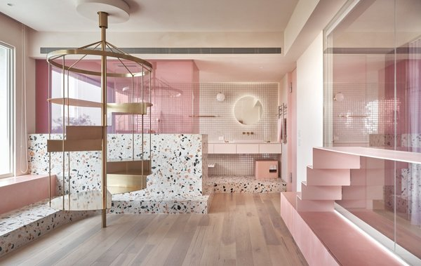 In a seaside holiday home in Taiwan, two goals were the focus of the design: a dominant pink palette, reflecting the homeowner's favorite color, and a feline-friendly interior for her three cats. The pink hues are offset by the easy-to-clean, dynamic terrazzo surfaces, and the pink is given depth and texture thanks to a mineral paint.