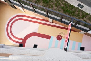 "The leftover outdoor space was converted into a mini basketball court for Mr. Yeh. ""We used geometric patterns and saturated color blocks to divide the basic court zones and reference the interior design."""