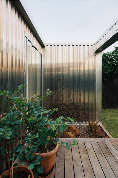 """""""The void in the veranda and deck creates a spectacular shaft of light that cuts across the shiny aluminum surface, reflecting rippled patterns into the house,"""" adds Mulla."""