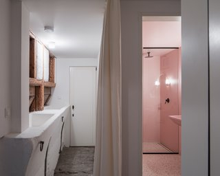 A peek into the new ground-floor guest bathroom, which is finished in pink paint.