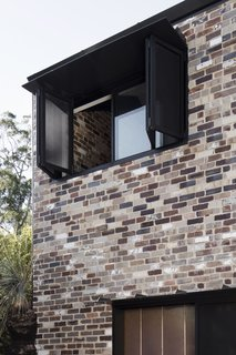 """The recycled brick honors the fabric of the existing cottage whilst adding robustness and patina to complement the rugged terrain of the lake reserve,"" say the architects. Only recycled bricks were used in the new construction."