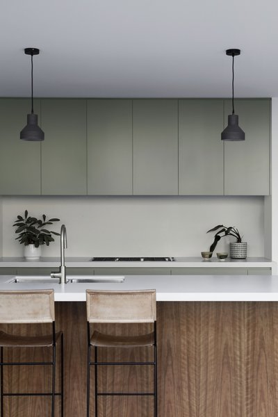 NSW spotted gum surfaces and cabinetry painted with Dulux Forest Canopy give the kitchen a calming, forest-like feel.