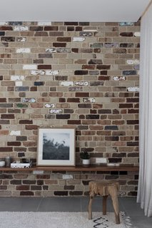 Recycled bricks, some of which were repurposed from the existing cottage, are celebrated in the new extension's interior and exterior.