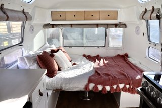 At night, the dinette is converted into a queen-sized bed.