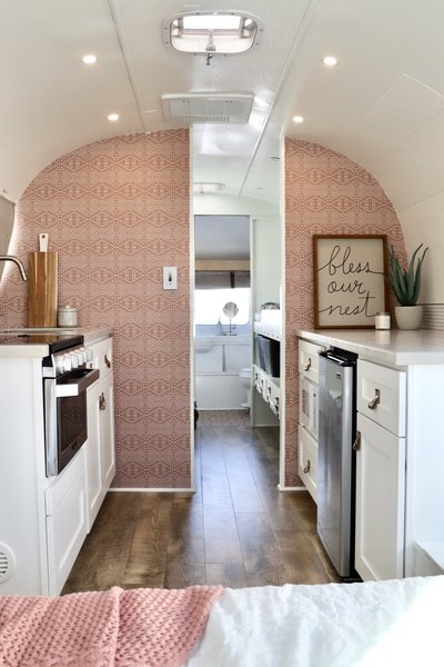 """Spoonflower Boho Tile Blush Dark wallpaper by Holli Zollinger adds a pop of color and texture that matches the clients' desire for a """"modern mountain cabin design aesthetic"""". The dimmable ceiling lights have separate zone controls."""