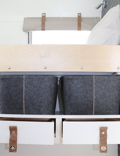 Colorado Caravan fit an abundance of storage into the renovated Airstream. All seating areas lift up for storage underneath. The bunks also have space on the floor for shoes in an extended toe kick, clothing bins, and drawers can be secured against bumpy rides.
