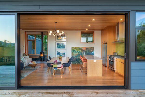 Designed for energy efficiency, the home features insulation above code and hydronic radiant heating. Note the Morso 6148 wood-burning stove in the entry hall that's fueled by locally felled lumber.
