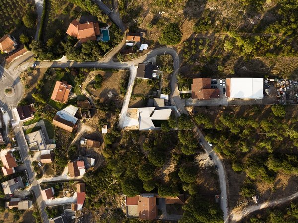 Located on the outskirts of Leiria, Portugal, Casa Povo shares greater similarities with the rocky landscape than its traditional gabled neighbors.