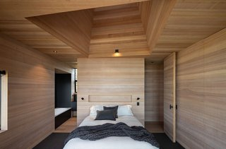 The light mine placed directly above the bed in the master bedroom frames views of the stars.